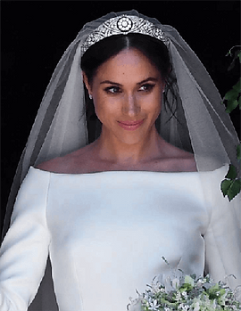 Meghan Markle, new Duchess of Sussex in her wedding dress and Diamond Bandeau Tiara loaned to her by Prince Harry's grandmother the Queen,standing in the doorwell of St. George Chapel, Windsor Castle England, on her wedding day, May 29, 2018