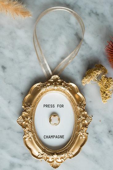 """Single """"Press For Champagne"""" Ornament"""