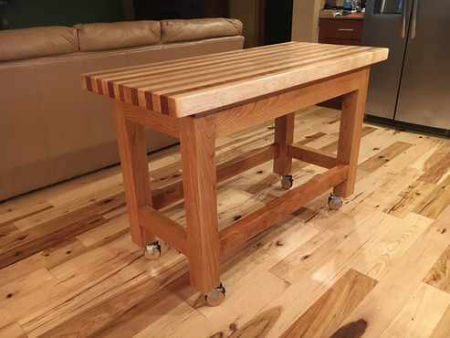 Cherry base with maple and cherry top.