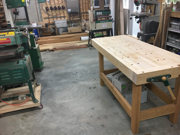 """Mike's handmade maple workbench and 15"""" planer on the left"""