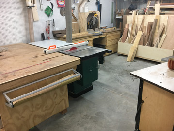 Table saw with large outfeed table, miter saw in the backround.