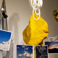 memory cards, yellow coat, rope, charcoal dust, silver, compass, cosmic fabric
