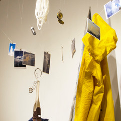 thread, tools of use, pic, charcoal dust, rope, compass, memory cards, yellow coat, carrier, grey bear, silver