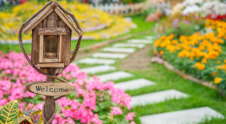 spring garden pathway to a home