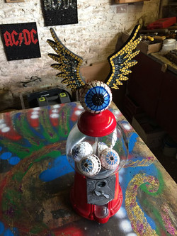 Winged eye gum ball (eyeball) machine