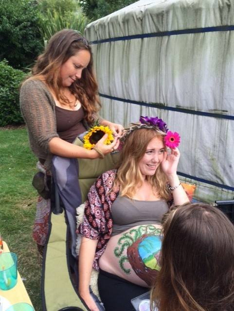I rarely take photos at ceremonies because they are sacred to me, so this is a rare mothers blessing photo of me creating my sisters flower crown with flowers from all of her friends and family, and being painted with a bear image, as bears meant a lot to my sister during this pregnancy. Taken 2016