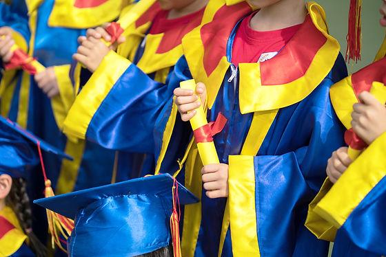 Kids Holding Diplomas