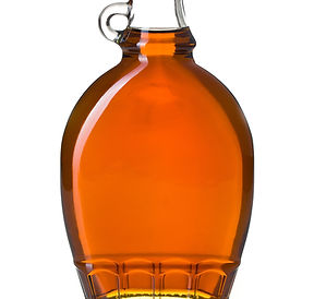 maple syrup in glass bottle on white bac