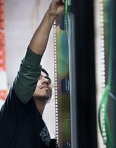 Man adjusting cables data center rack