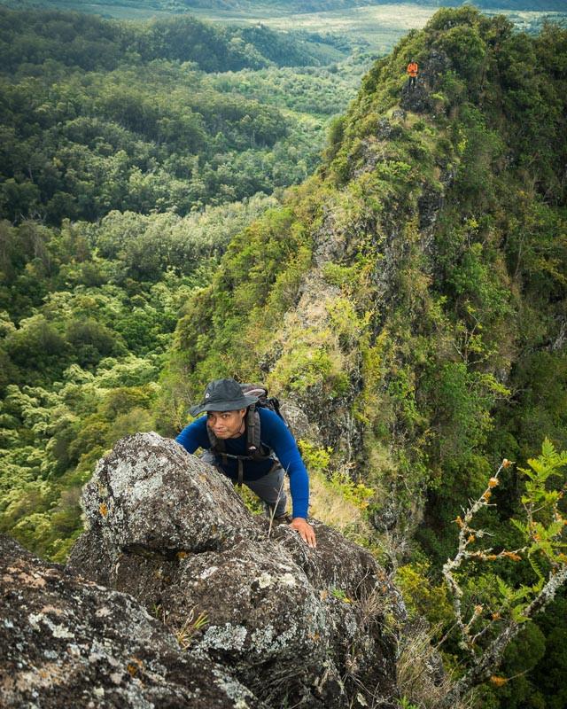 hiker on narrow ridge