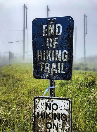 end of trail sign on top of Mt Kaala