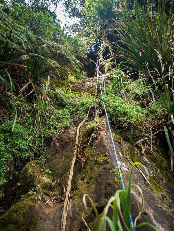 hiker descending on ropes