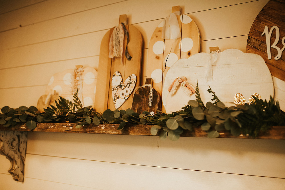 greenery garland and wooden pumpkins from Etsy