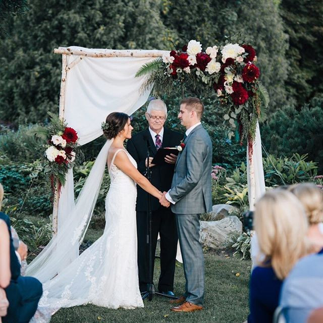 burgundy and white wedding arbor arch