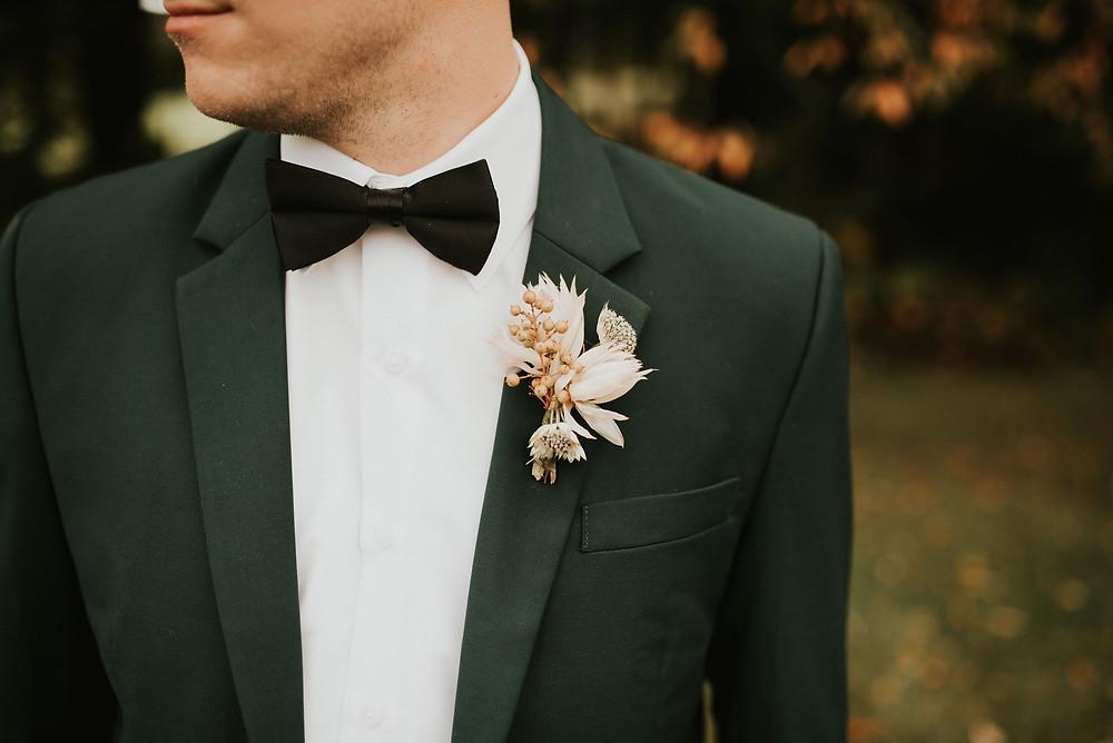 blushing bride protea boutonnière