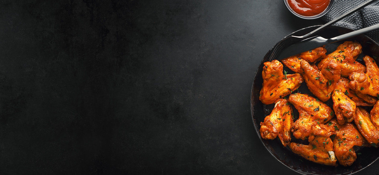 chicken-wings-grilled-in-sauce-on-pan-U2