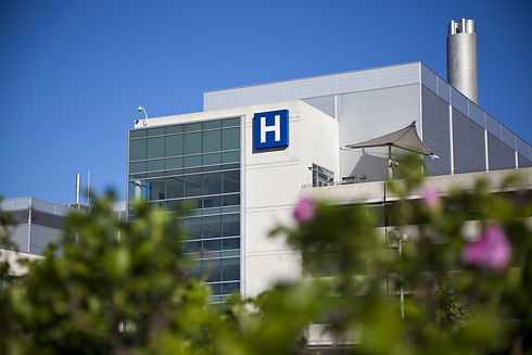 Modern hospital and sign with clear blue
