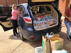 Volunteers unloading groceries