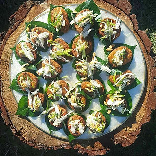 Cargo Catering Co. canapes Thai fish cakes on beatle leaf