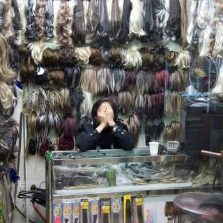 TEHRAN - Woman selling wigs