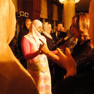 CAIRO - Women at a wedding dancing