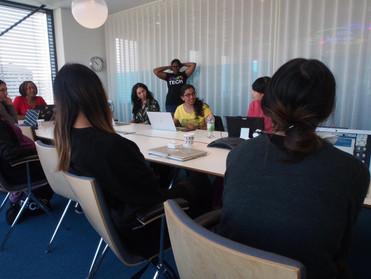 women of colour around table