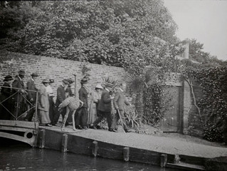 EABowles leads a party across the  New River at the Wisteria Bridge at Myddelton House Gardens circa