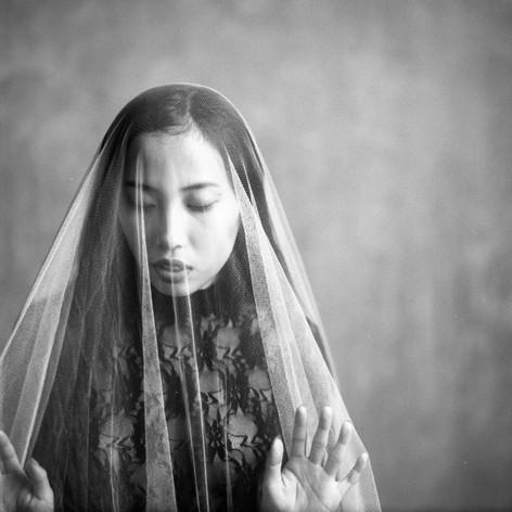 Imprisoned in the veil