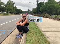 Rowena by her sign.JPG