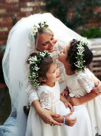 cuties flower girls with mommy . a braidcrown and a little bun for them;