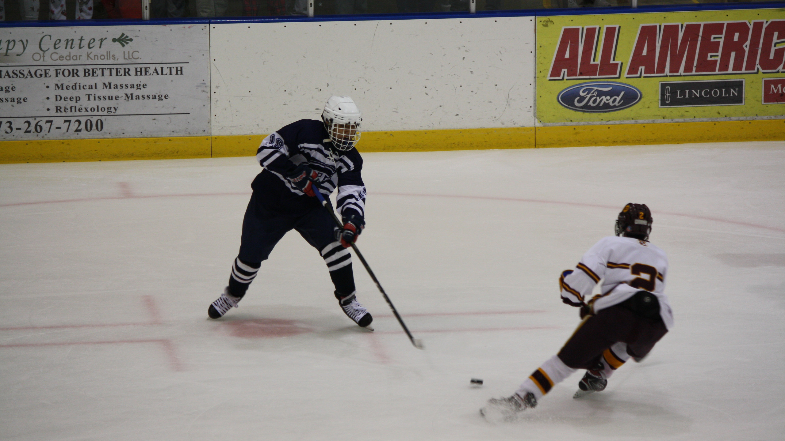 Chatham's Gabriel Park looks to steal the puck against Madison. (Mike Gurnis | The Morris-Sussex Hockey Report)