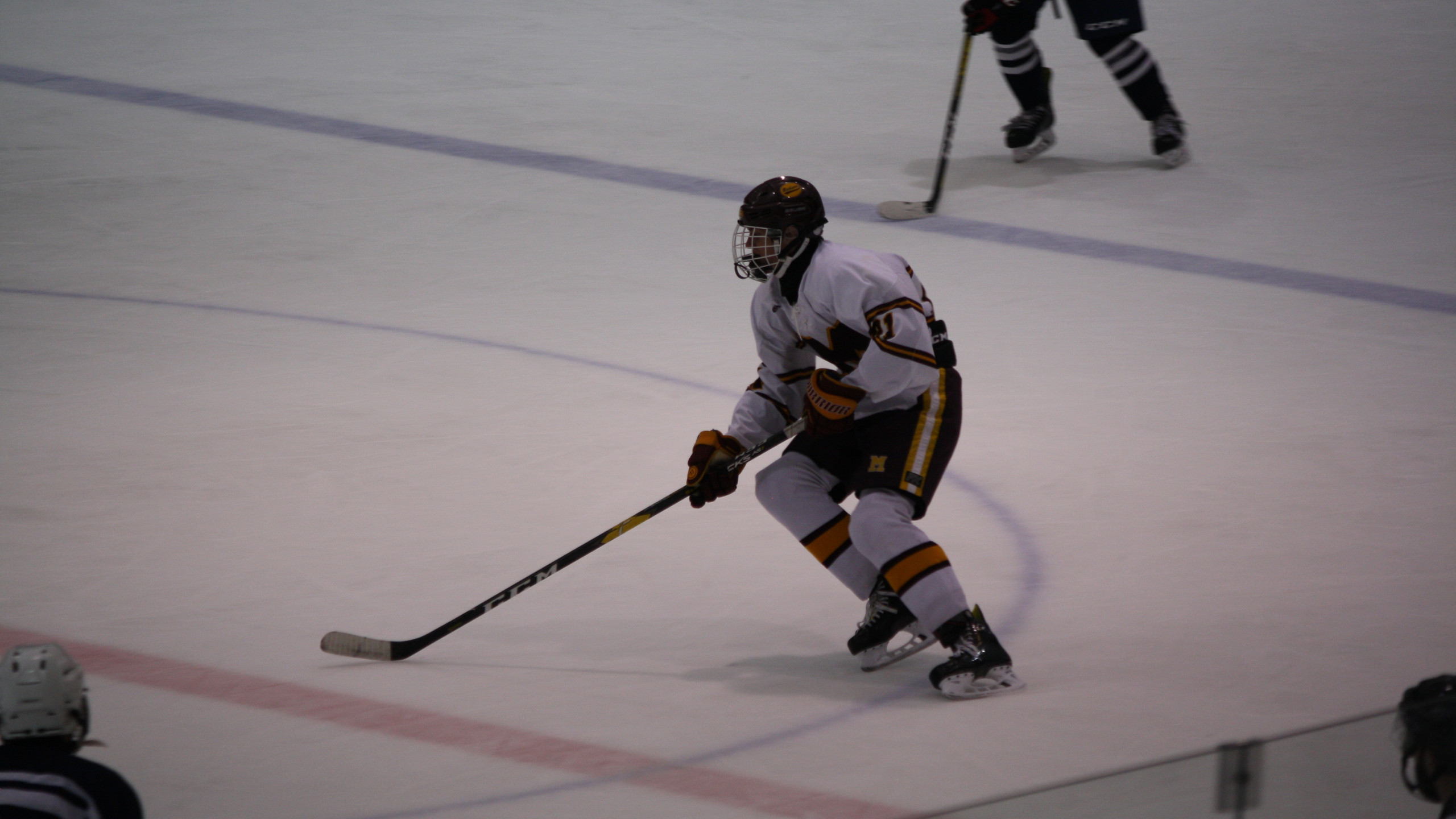 Madison's Matt Leone takes the puck through the neutral zone. (Mike Gurnis | The Morris-Sussex Hockey Report)