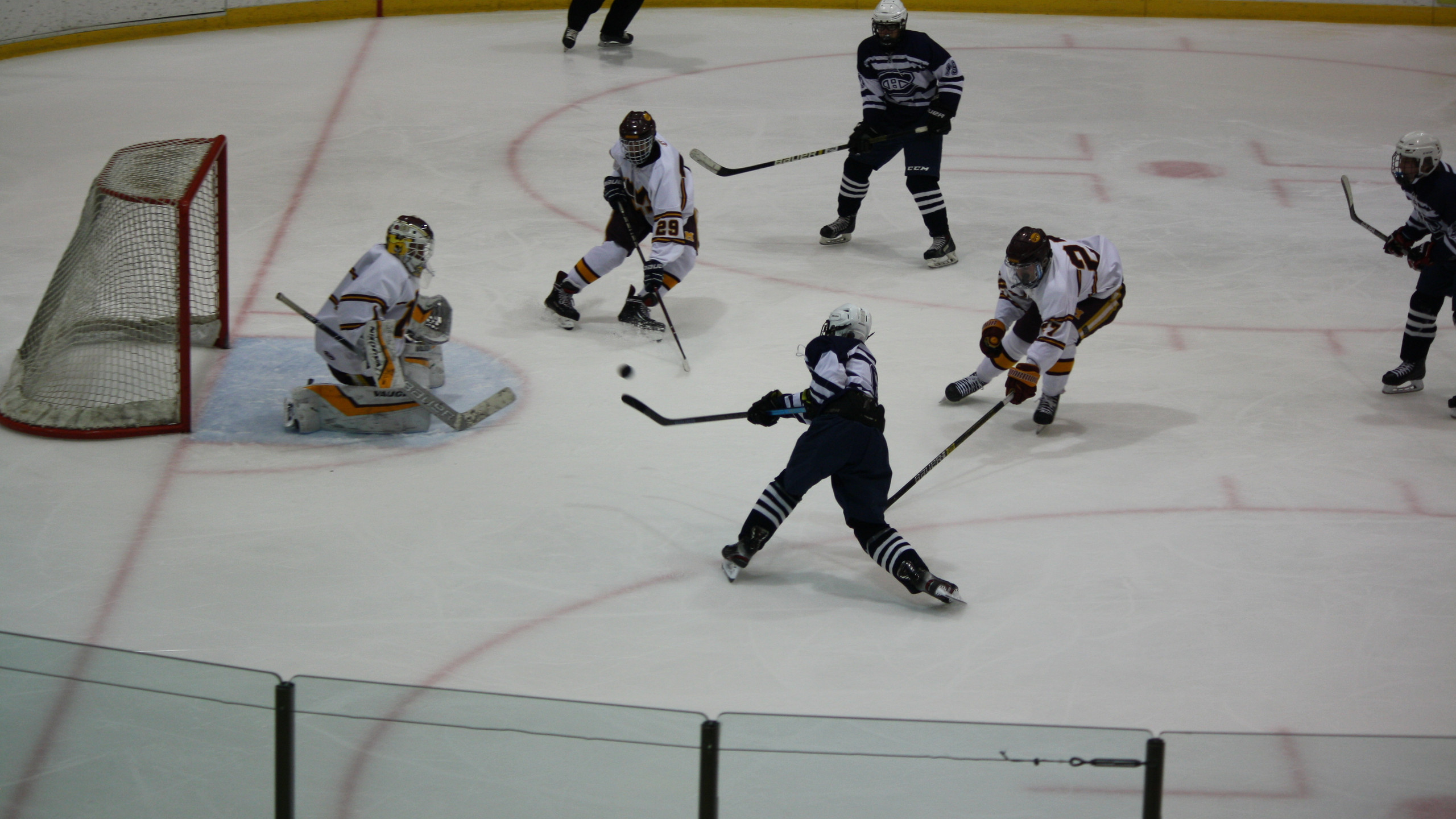 Chatham's Will White shoots and scores against Madison. (Mike Gurnis | The Morris-Sussex Hockey Report)