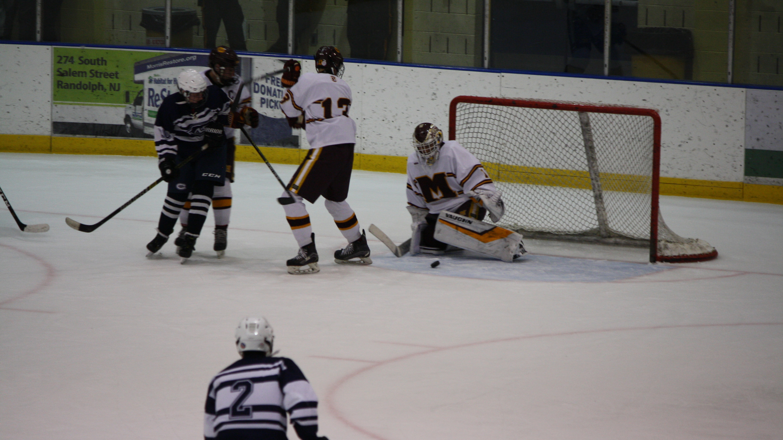 Madison goalie Keaton Tom makes a save against Chatham. (Mike Gurnis | The Morris-Sussex Hockey Report)