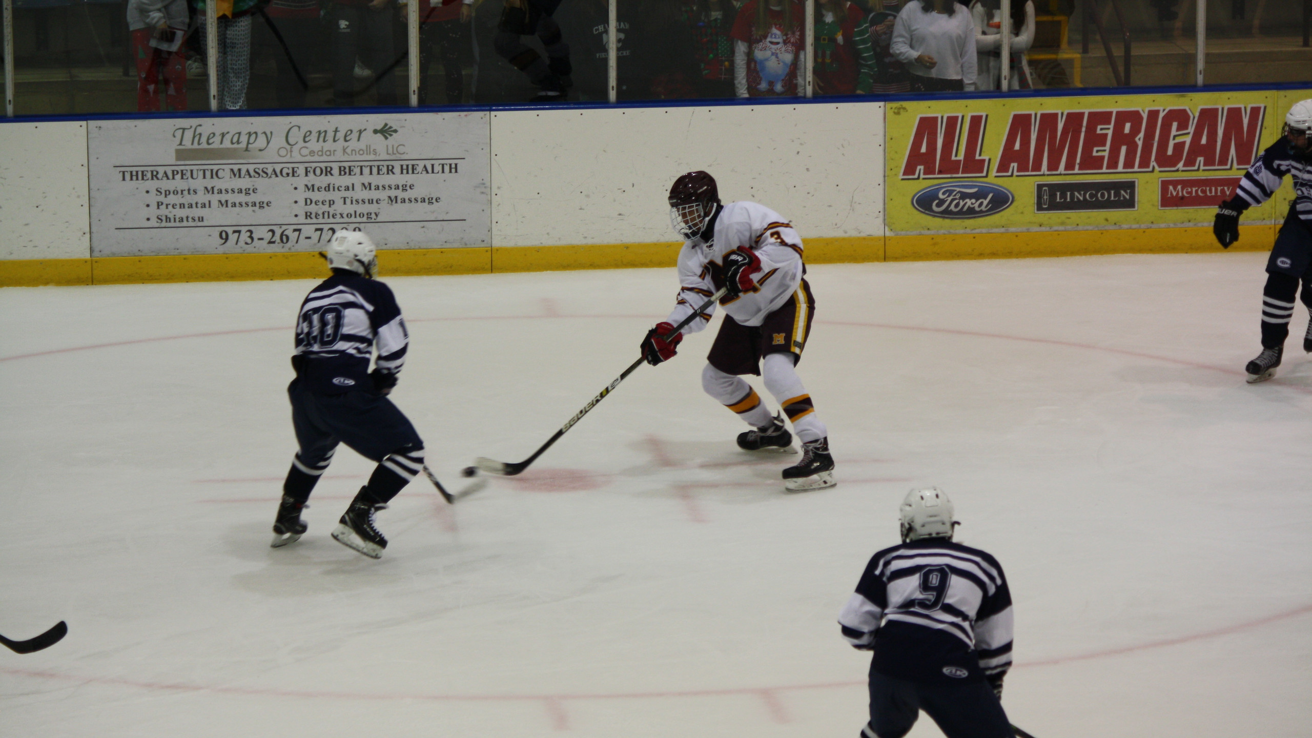 Madison's Jacoby Erickson handles the puck against Chatham. (Mike Gurnis | The Morris-Sussex Hockey Report)