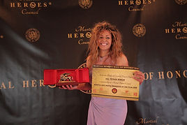 Suza and her award.jpg