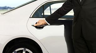 Chauffeur hand opening car door.jpg
