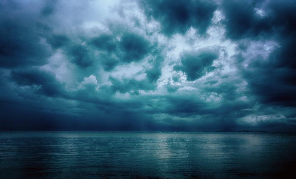 Dramatic stormy dark cloudy sky over sea