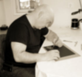 T. Malm drawing with his left hand