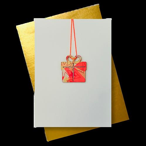 * Geschenk