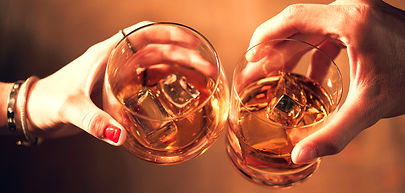 closeup-shot-of-two-people-clinking-glas