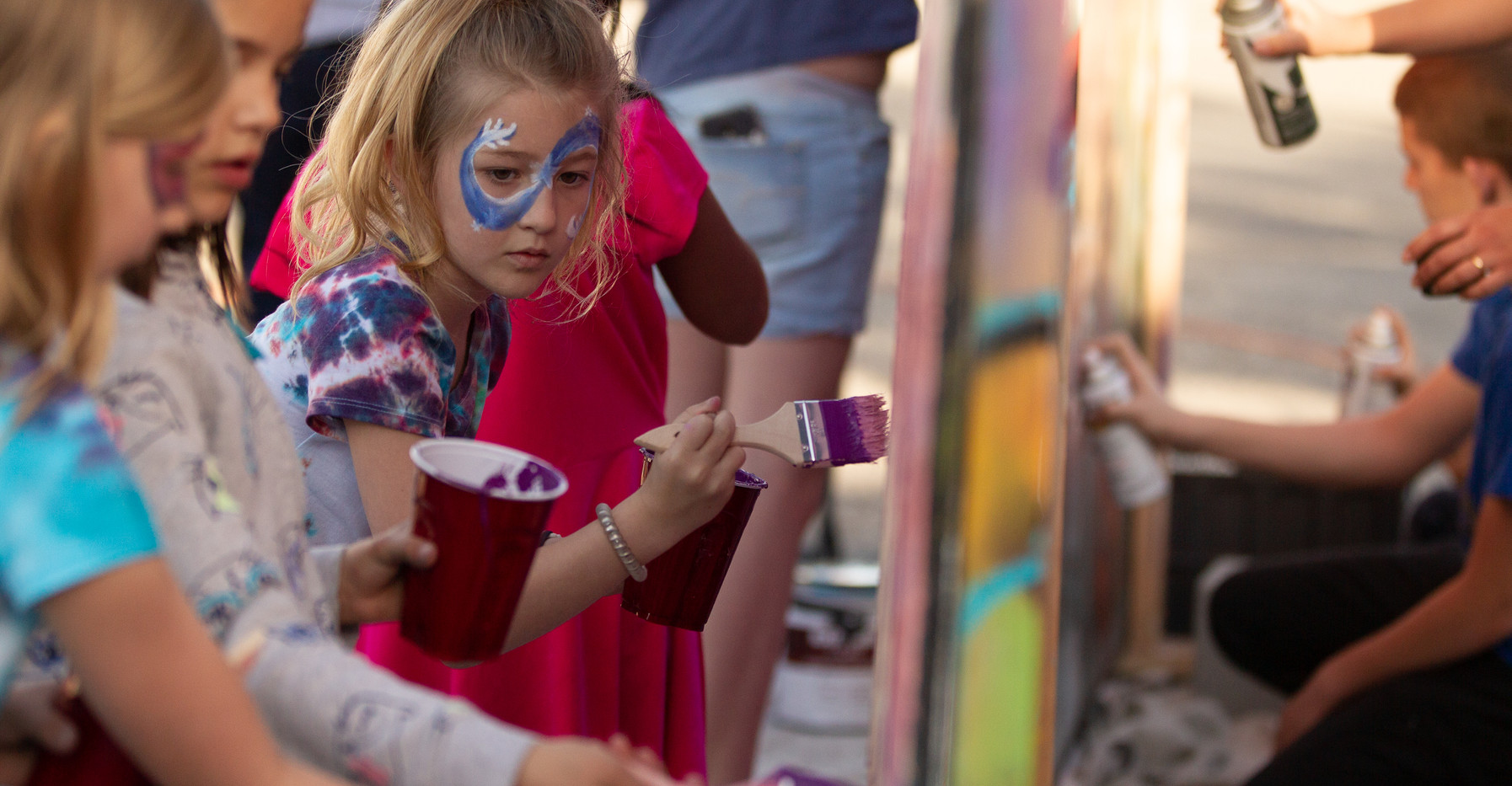 Face painting at Mural Fest