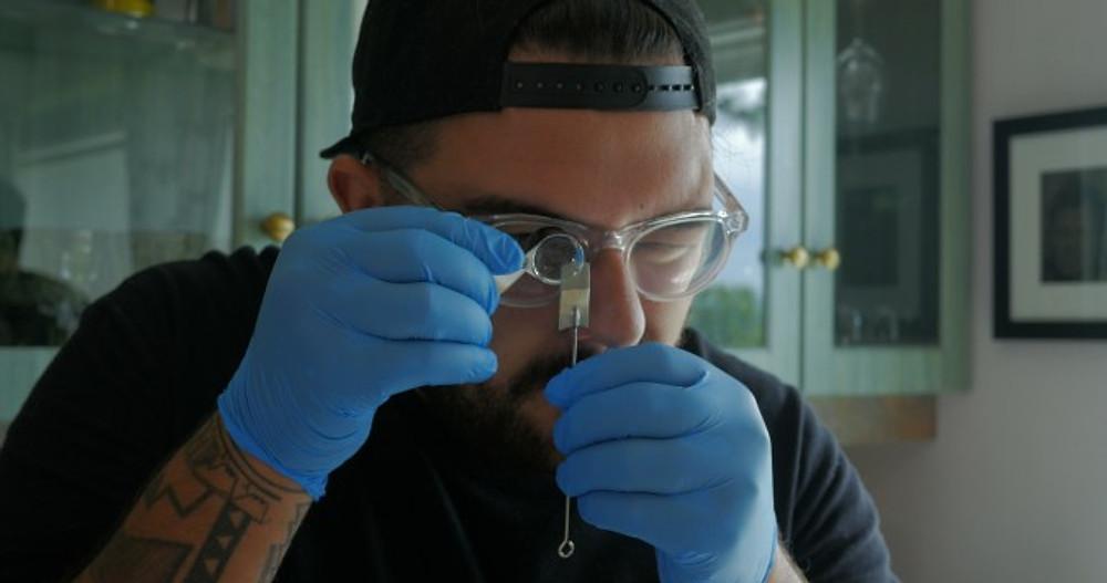Checking Needles at Earth Line Tattoo Residency. Photo Kiano Zamani