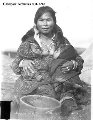 Breastfeeding Inuit Woman with Tattos