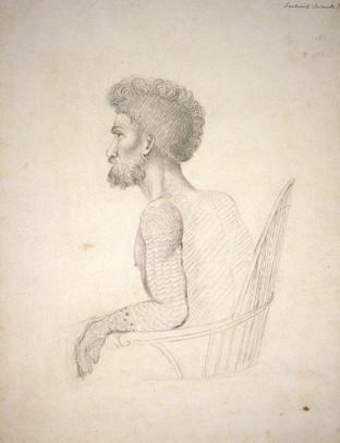 Seated Tattooed Hawaiian Man