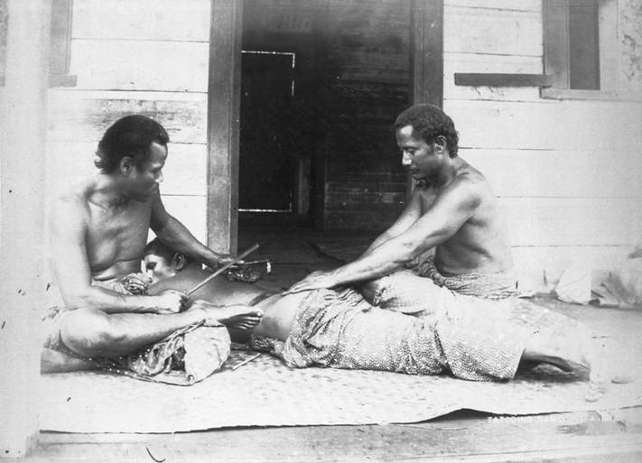 Samoan Tattooist at Work