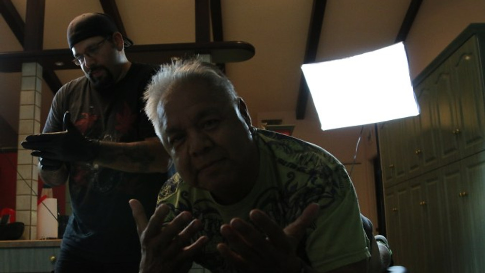 Tattooing James Luna as part of the Indigenous Summer Intensive 2015