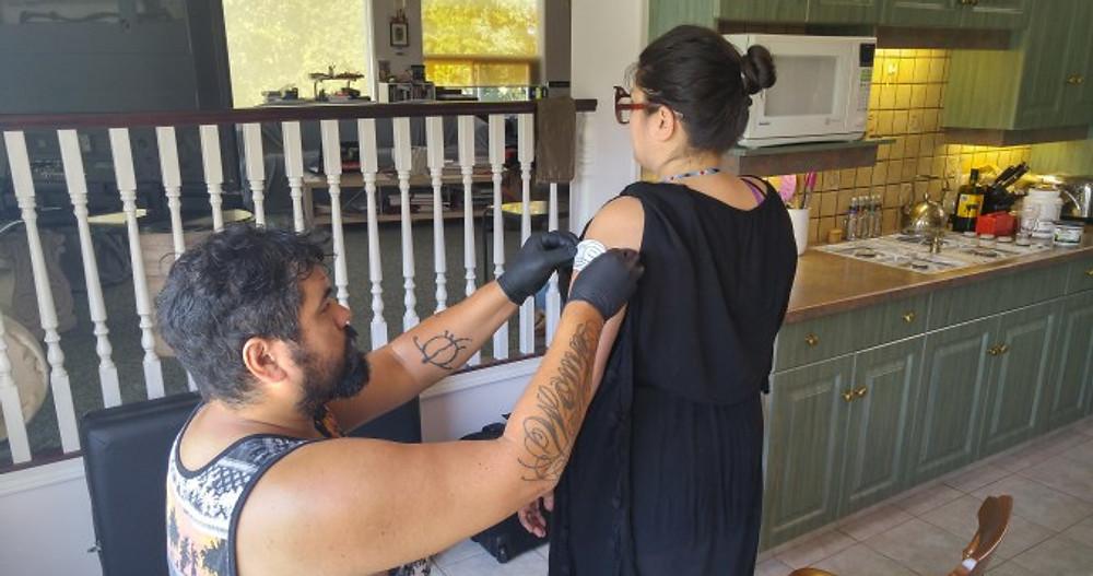 Applying Stencil at Earth Line Tattoo Training Residency