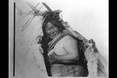 Inuit Arm Tattoos on Woman