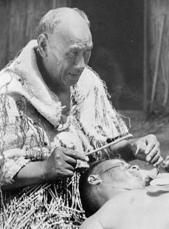 Tattooing Moko on Man's Face